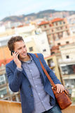 Man on smart phone - young business man talking. On smartphone. Casual urban professional businessman using mobile cell phone smiling happy walking. Handsome Stock Photos