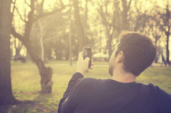 Man with smart phone Stock Photography
