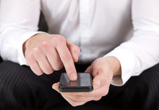 Man with a smartphone Stock Images