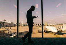 Man with smartphone at airport royalty free stock images