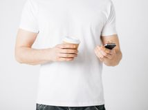 Man with smartphone and coffee Stock Photography