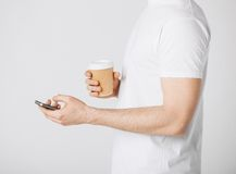 Man with smartphone and coffee Royalty Free Stock Photos
