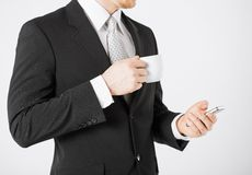 Man with smartphone and cup of coffee Royalty Free Stock Photography