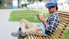 Man with smartphone drinking coffee on city street 52 stock video
