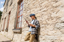 Man with smartphone drinking coffee on city street Royalty Free Stock Photo