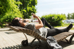 Man with smartphone and earphones listening music Royalty Free Stock Image