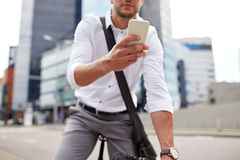 Man with smartphone and fixed gear bike on street Royalty Free Stock Image