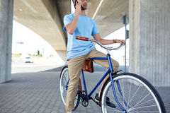 Man with smartphone and fixed gear bike on street Stock Images
