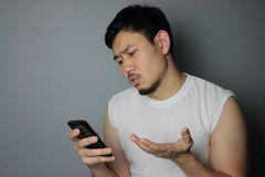 A man and smartphone. A man get bad news from mobile phone royalty free stock photo