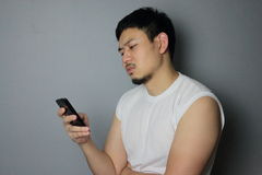 A man and smartphone. A man get bad news from mobile phone stock images