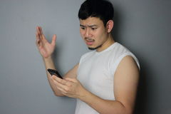 A man and smartphone. A man get bad news from mobile phone royalty free stock photography