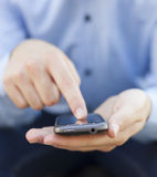 Man with smartphone in hand Royalty Free Stock Photo
