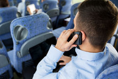Man with smartphone and laptop in travel bus Royalty Free Stock Photo