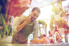 Man with smartphone making notes at flower shop Stock Photos