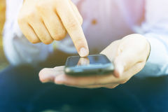 Man with smartphone searching news Stock Photo