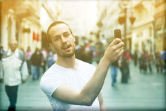 Man with smartphone take photo Stock Image