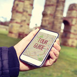 Man with a smartphone with the text tour guide Stock Images