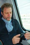 Man with smartphone in a train royalty free stock images