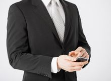 Man with smartphone typing something Royalty Free Stock Photo