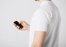 Man with smartphone typing something Royalty Free Stock Images