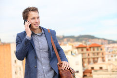 Man on smartphone - young business man talking stock image