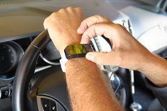 Man with SmartWatch in a car 2 Royalty Free Stock Photography