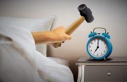 Man smashing alarm clock with sledge hammer Royalty Free Stock Photos