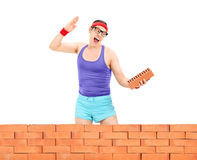 Man smashing a brick behind a wall Royalty Free Stock Photos