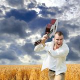 Man smashing guitar Royalty Free Stock Images