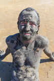 Man smeared with healing mud Stock Photos