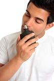 Man smelling aftershave cologne stock images