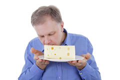 Man smelling cheese Stock Image