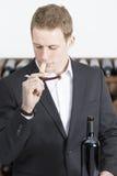 Man smelling a cork Stock Photos