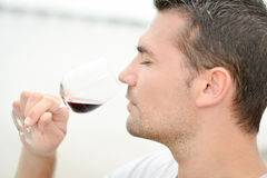 Man smelling glass red wine Stock Photo