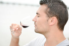 Man smelling glass red wine Royalty Free Stock Photo