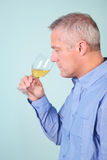 Man smelling a glass of white wine Royalty Free Stock Image