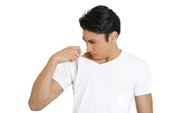 Man smelling himself Royalty Free Stock Photos