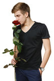 Man smelling the red rose Royalty Free Stock Images