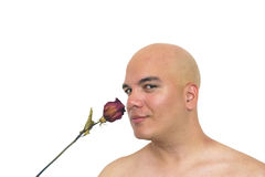 Man smelling a red rose. Closeup of a man smelling an old red rose  on a white background Royalty Free Stock Photography