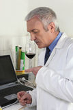 Man smelling red wine. And analyzing fragrances Royalty Free Stock Photos