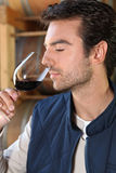 Man smelling red wine fragrances Stock Photo
