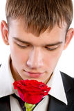 Man smelling a rose Stock Photography