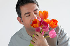 Man smells a bouquet of Tulips flowers Royalty Free Stock Images