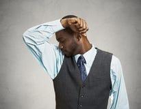 Man smells his armpit, bad odor Royalty Free Stock Image