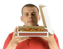 Man smells pizza. Isolated man smells pizza Stock Image