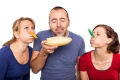 Man smells on a stinky cheese Stock Photos