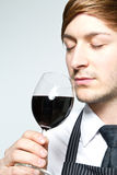 Man smells wine Royalty Free Stock Images