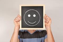 Man with smile in blackboard Stock Image