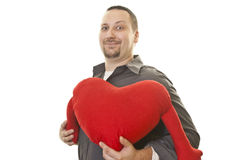 Man with a smile holding heart for Valentine Day Stock Image