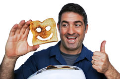 Man smile and holds a good slice of toast Stock Photos